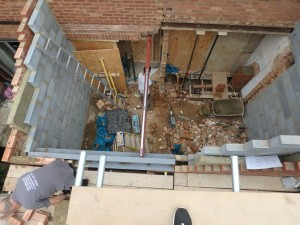 Bricks up to first floor Acton kitchen extension W3